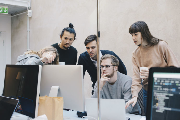 Group of people working on laptop