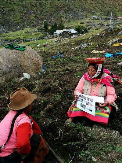 Community Health Worker, Ana Cecilia, meets with her neighbor on the field to conduct womens health baseline surveys. Sacred Valley - Peru Inca City Cusco Publichealth Sacredvalleyhealth NGO Nature Beauty In Nature Mountain Potatoes On The Field
