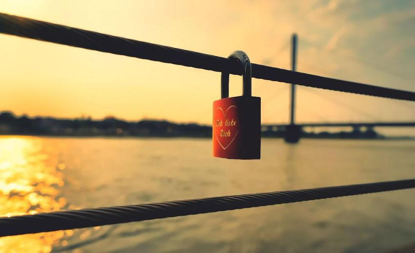 Water Railing Metal Protection River Love Lock Focus On Foreground Lock Love Sky Close-up Sunset No People Outdoors Hanging Red City Skyline Düsseldorf Long Goodbye