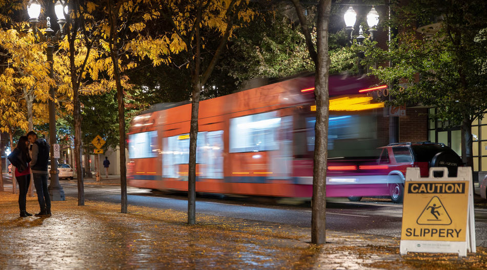 The Art Of Street Photography Transportation Mode Of Transportation Motion Land Vehicle Tree Blurred Motion Public Transportation City Street Speed Plant Illuminated Road Architecture Real People on the move Night Men Outdoors Travel