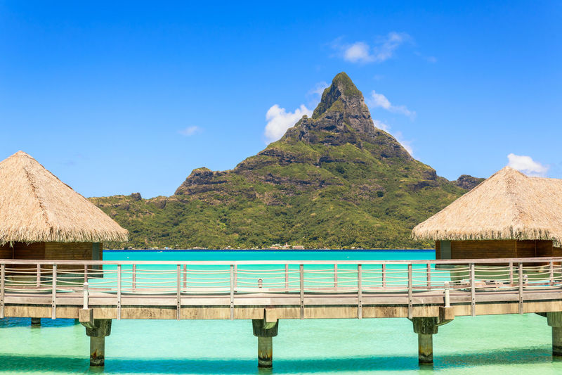 Otemanu mountain view and traditional overwater bungalow's with stunning lagoon at Bora-Bora, Tahiti, French Polynesia Blue Bora Bora Lagoon Resort Bungalows Idyllic Lagoon Water Landscape Luxury Mountain Otemanu Mountain Outdoors Paradise On Earth Romantic Scenics Sky Summer Sunny Tahiti ❤ Tranquil Scene Travel Destinations Tropical Climate Water