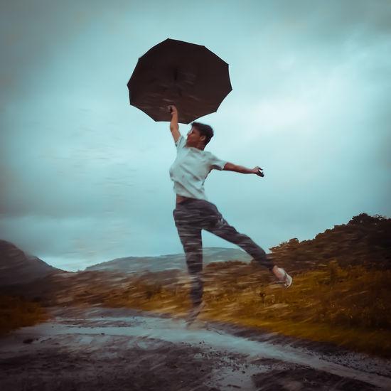 Full length of man jumping on mountain