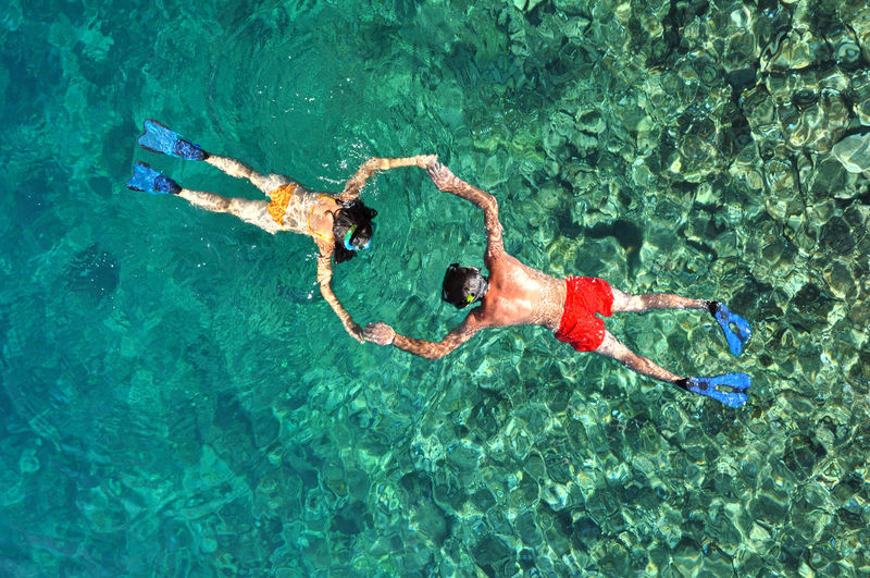 Romantic couple snorkeling in Phuket, Thailand Drone  Drone Shot Snorkeling Adult Adventure Coral Reef Drone Photography Dronephotography Droneshot Friendship High Angle View Leisure Activity Lifestyles Nature Ocean Outdoors Sea Snorkel Swimming Swimming Pool Togetherness Turquoise Water Two People Vacations Water