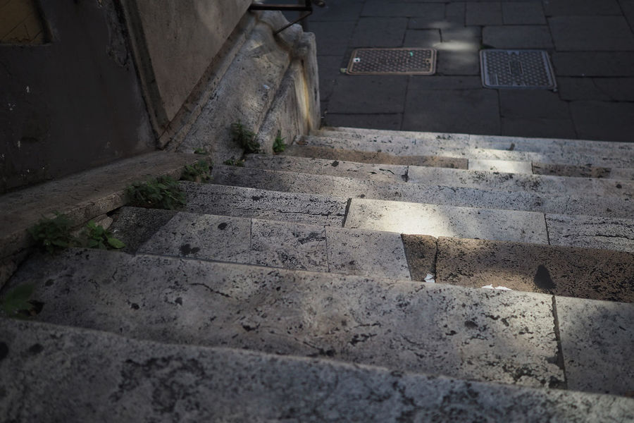 Lighting the path Steps Stairs Stone Rome Roman Worn Weathered Path Way Ahead Light Shadow Close-up Paving Stone Weathered Paved Pavement Footpath Staircase Stairway Steps And Staircases Civilization