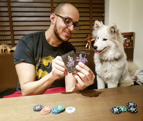 Poker night, with fluffy partner. Poker Chips Dog Poker Poker - Card Game Poker Night Poker Pets Dog Only Men Adults Only One Animal Adult One Person Domestic Animals Casual Clothing Responsibility Friendship