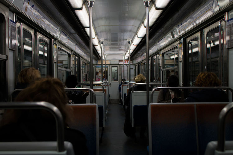 Rear view of people sitting in train