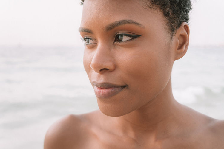 Close-Up Of Woman Looking Away At Beach