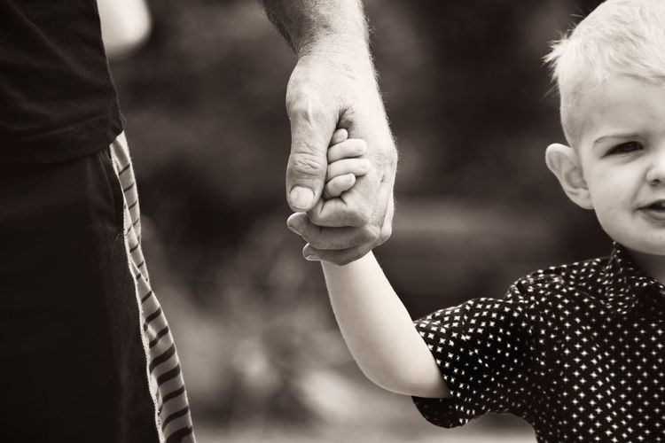 Grandpa's Hand Adult Childhood Close-up Day Focus On Foreground Grandchildren Grandfather, Human Arm Human Body Part Human Hand Leisure Activity People Real People Togetherness Two People
