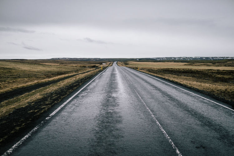Iceland; Roadtrip Road Transportation Environment Sky The Way Forward Landscape Direction Cloud - Sky vanishing point Highway Land No People Diminishing Perspective Nature Horizon Over Land Horizon Country Road Sign Day Absence Outdoors Dividing Line