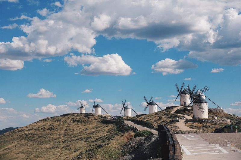 View of traditional windmills against sky