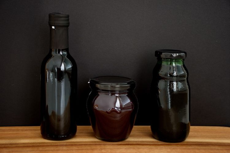 Container Bottle Glass - Material Table Still Life Indoors  No People Jar Close-up Food And Drink Wood - Material Choice Group Of Objects Variation Food Side By Side Drink Black Black Background Wooden