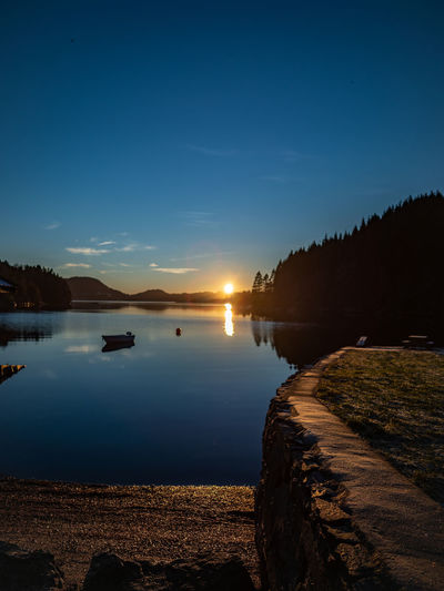 Sunset off Hordnes Water Sky Scenics - Nature Beauty In Nature Tranquility Reflection Tranquil Scene Lake Nature Sunset Tree Non-urban Scene No People Idyllic Silhouette Plant Nautical Vessel Outdoors Fjordsofnorway Sunset_collection Sun Down Landscape
