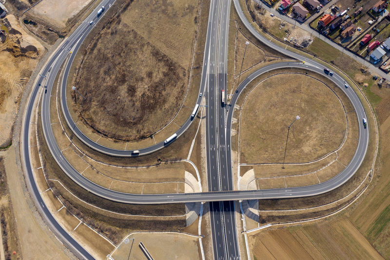 Aerial top view of highway intersection, drone shot Road Transportation High Angle View Aerial View Day Architecture City Highway Highways&Freeways Highwayphotography Road Travel Intersection Highway Intersection Drone  Drone Photography Droneshot Cityscape Aerial Aerial Photography Aerial Shot Romania Infrastructure Overpass Motorway