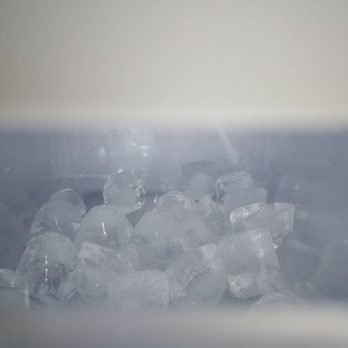 Close-up of ice crystals against white background