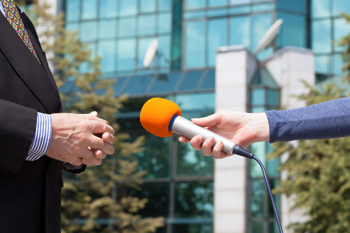 Journalist interviewing businessperson, corporate building in background Interview Journalist Press Suit Broadcasting Building Businessman Comment Communication Corporate Hand Holding Information Journalism Media Microphone News Person Politician Question Report Reporter Unrecognizable Person