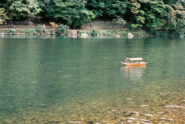 Analog Analogue Photography Arashiyama Exploring Film Film Photography Japan Outdoors Reflection Remote Boat Rippled River Riverbank Standing Water Tiny Boat Tranquil Scene Tranquility Tree Trip Vacations Water