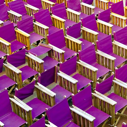 Purple folding chairs at the bandstand in Eastbourne, East Sussex, UK Bandstand Eastbourne Folding Chair Chairs Architecture Built Structure Building Exterior Full Frame Backgrounds Purple Pink Color In A Row No People High Angle View Pattern Repetition Outdoors Side By Side