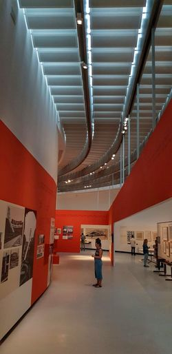 MAXXI Contemporary Art Museum of Rome, Italy Glow Dim Light Red Blue Samsungphotography Zaha Hadid Full Length Architecture Architectural Design Ceiling Hanging Light Recessed Light Roof Beam Interior Architecture And Art Light Fixture