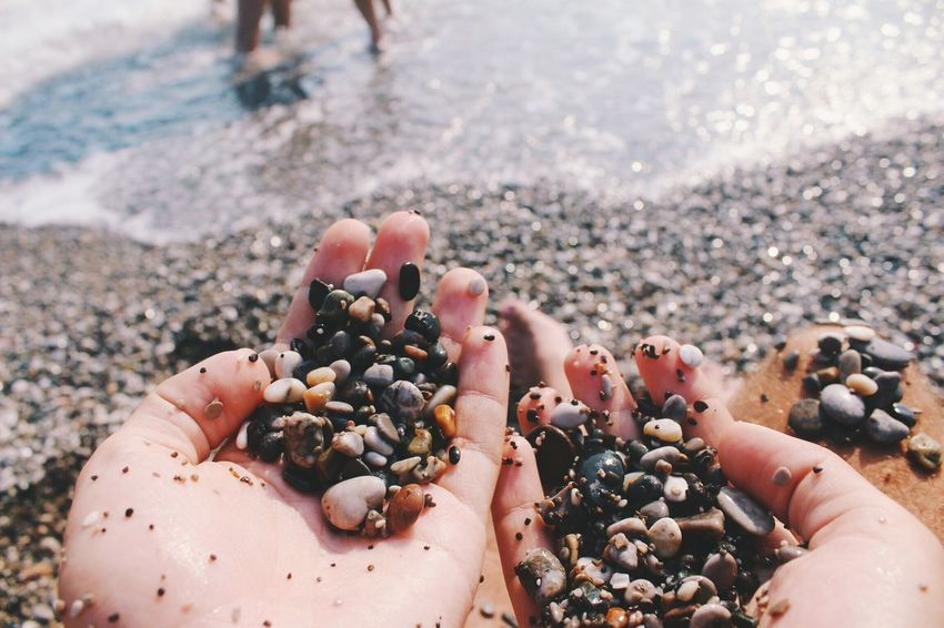 Last days of summer Memories Summer Beach Variation Close-up Collection Large Group Of Objects Selective Focus Pebble Abundance Freshness Holding Sea Day Extreme Close Up Person Focus On Foreground Sommergefühle