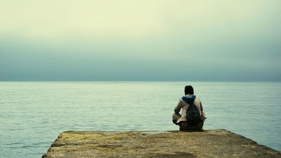 Sitting One Person Sea People One Man Only Adults Only Full Length Beach Outdoors Only Men Nature Day Adult Young Adult Black Sea Shore Foggy Day ! Seascape Photography Loneliness Universe In My Eyes Universe Calm Sea Calmness Dreamscape Dreamscapes & Memories Nature Photography Long Goodbye