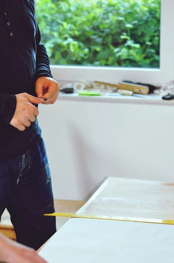 EyeEm Selects Midsection One Person Real People Standing Men Holding Casual Clothing Day Human Hand Indoors  Lifestyles Human Body Part Close-up Young Adult People EyeEmNewHere Paperhanging Working Paint Roller