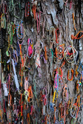 Multi colored ropes hanging on rope
