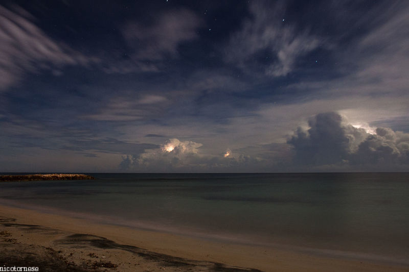 Night storm Sea Beach Horizon Over Water Sky Tranquility Beauty In Nature Nature Scenics Night Tranquil Scene Dramatic Sky Outdoors Sand Star - Space Astronomy No People Water Cloud - Sky Space Milky Way Storm Storm Cloud