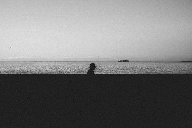 Old Shipping Days Beauty In Nature Blackandwhite Cinematography Clear Sky Contrast Copy Space Day Film Horizon Over Water Nature One Person Outdoors Scenics Sea Shadow Silhouette Sky Standing Tranquil Scene Tranquility Water The Street Photographer - 2017 EyeEm Awards