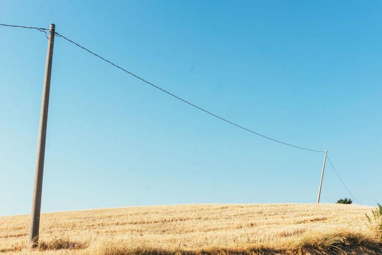 Agriculture Beauty In Nature Blue Cable Clear Sky Connection Day Electricity  Electricity Pylon Field Grass Growth Italy Landscape Marche Nature No People Outdoors Rural Scene Scenics Sky Telephone Line Tranquil Scene Tranquility