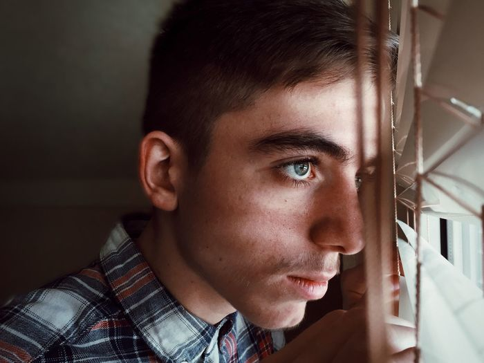 Looking through the window Portrait Nephew  People Portrait Photography People EyeEm Shadow Lights Shadows & Lights EyeEm Selects Eye4photography  EyeEm Gallery Still Life Light Headshot Portrait One Person Real People Close-up Young Adult Lifestyles Indoors  Body Part Looking Front View Human Face Looking Away Human Body Part Teenager The Portraitist - 2019 EyeEm Awards