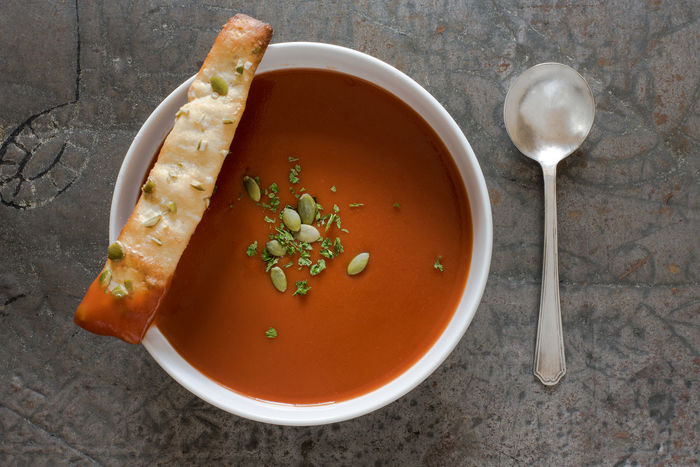 Tomato Soup with Pumpkin Seed Breadstick Autumn Homemade Red Breadstick Comfort Directly Above Food High Angle View No People Pepita Pumpkin Seed Ready-to-eat Soup Tomato Top View Vegetable Soup Warm