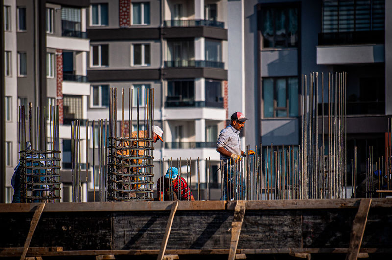 Man working at construction site in city