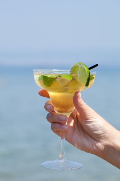 Beach Cocktail Drink Fruit Glass Hold Horizontal Ocean Refreshment Resort Sea Seaside Thirst Thirsty  Tropical Water Woman