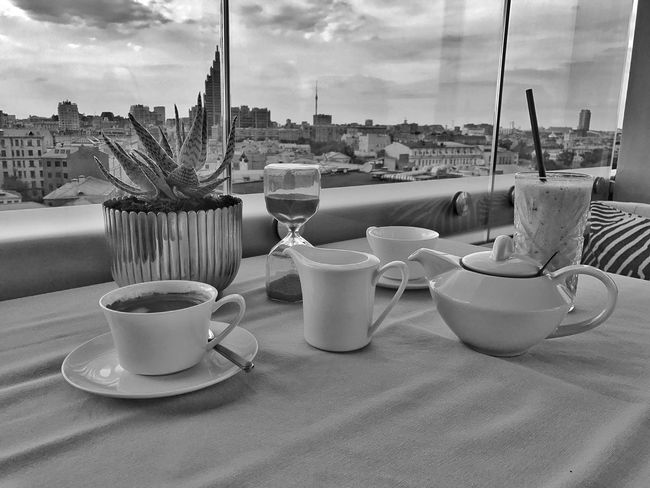 Summer bw Perfection Daydreaming Togetherness Summertime Summer Vibes Summer Views Urban Photography Urban Lifestyle Urban Skyline Lifestyle Moscow Black&white Black And White Photography Chilling Meeting Friends Cup Food And Drink Table Drink Mug Refreshment Architecture Building Exterior Coffee Cup Spoon Sky Restaurant