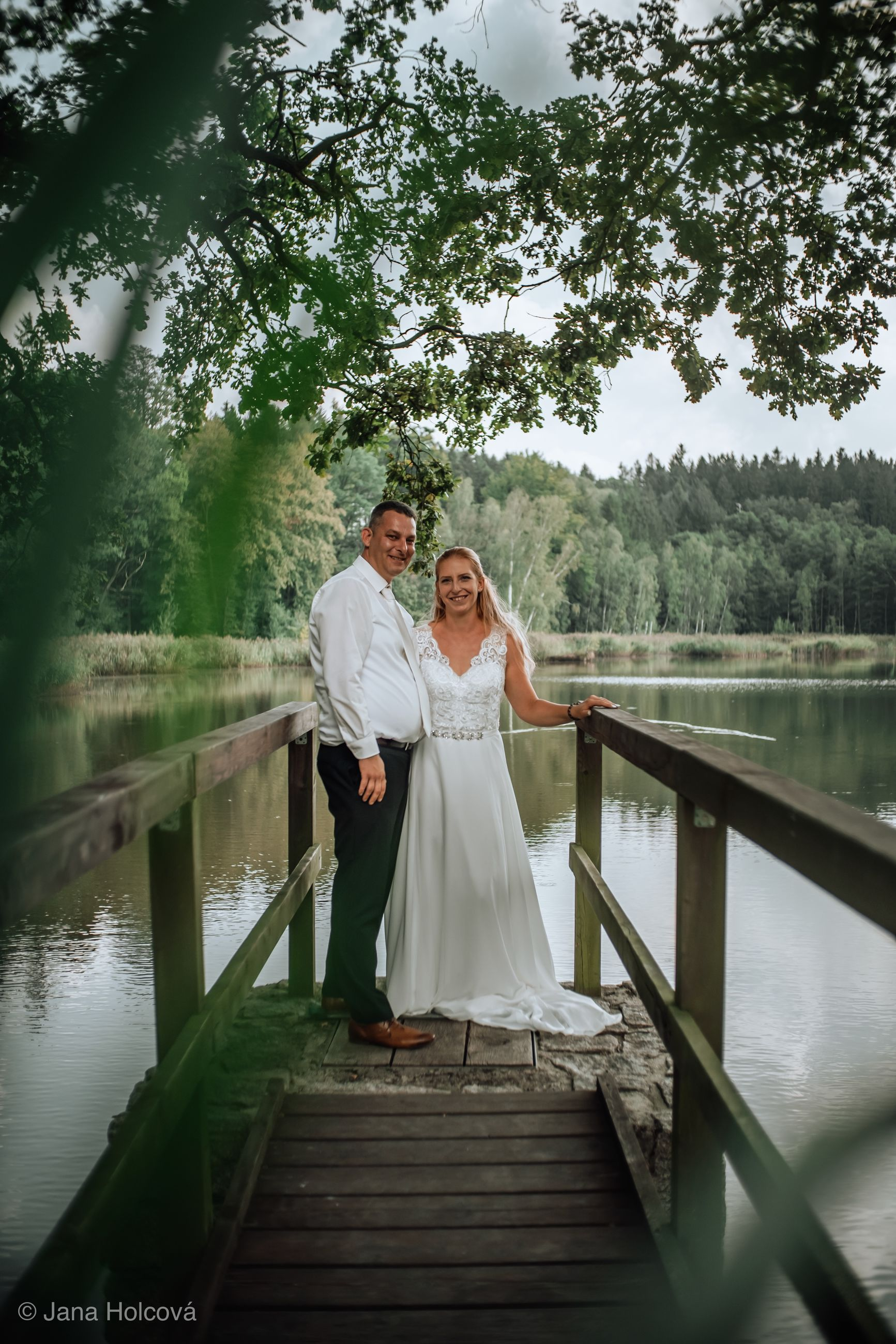 love, women, water, couple - relationship, two people, bride, wedding dress, adult, togetherness, wedding, life events, emotion, real people, newlywed, men, lake, positive emotion, bridegroom, tree, mature men