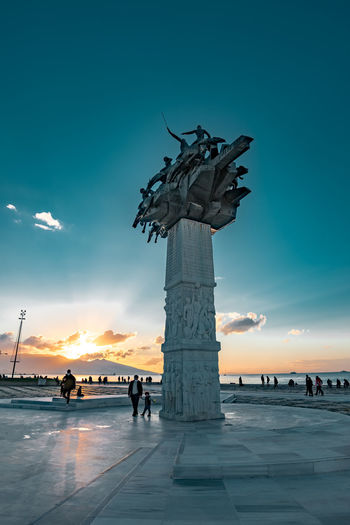 Silhouette statue against blue sky during sunset