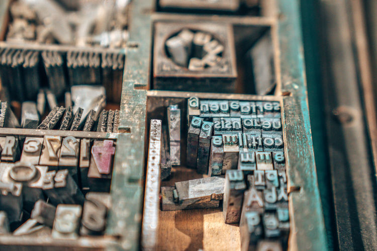 Old typography printing machine with letter samples.