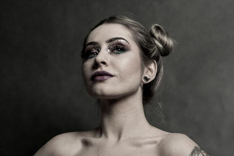EyeEm Gallery Beauty Black Background Close-up Make-up One Person Portrait Studio Photography Studio Shot Tattoos Women Womentattoo Young Women