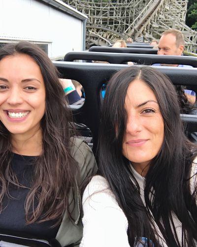 Portrait Of Female Friends On Rollercoaster