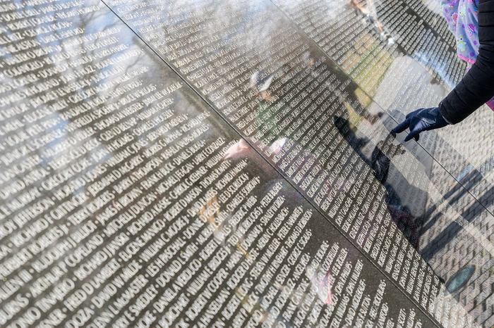 America Capital Cities  D.C. Day Fallen Hand Memorial Names Reflections Sightseeing Soldier USA Vietnam Vietnam War Memorial Wall War Washinton