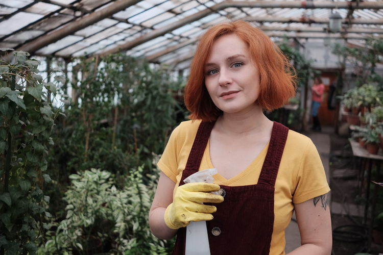 Young ginger gardener in a greenhouse