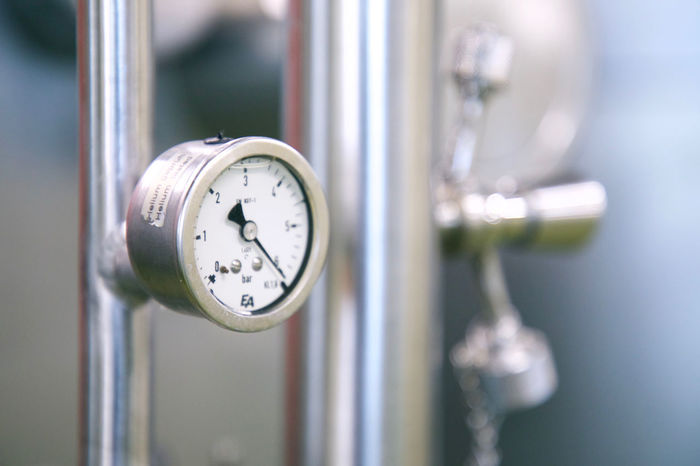 full pressure Fluids High Pressure Inanimate Industry Objects Beauty Cold Cold Temperature Electric Light Electricity  Factory Indoors  Liquids  Metal Neon Lights Pipes Selective Focus Silence Stainless Steel