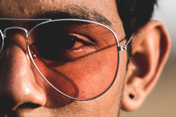 One Person Real People Close-up Glasses Eyeglasses  Lifestyles Human Body Part Adult Fashion Headshot Men Focus On Foreground Leisure Activity Young Adult Body Part Indoors  Portrait Mid Adult Looking Human Face Hairstyle Eyewear Personal Accessory
