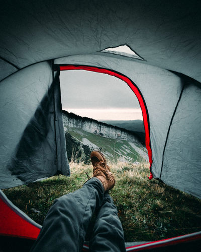 Enjoying the view out of my tent up in the astonishing swiss mountains Transportation One Person Mode Of Transportation Real People Rear View Leisure Activity Sitting Lifestyles Day Nature Relaxation Travel Vehicle Interior Car Tent Adventure Journey Motor Vehicle Casual Clothing Outdoors