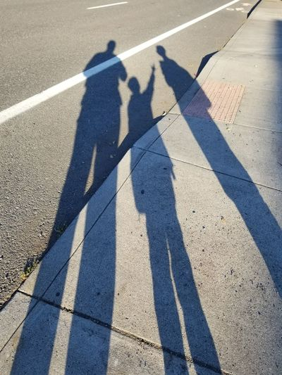 High angle view of shadows on street in city