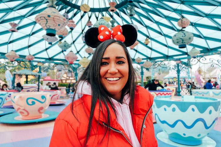 Portrait of smiling young woman in amusement park