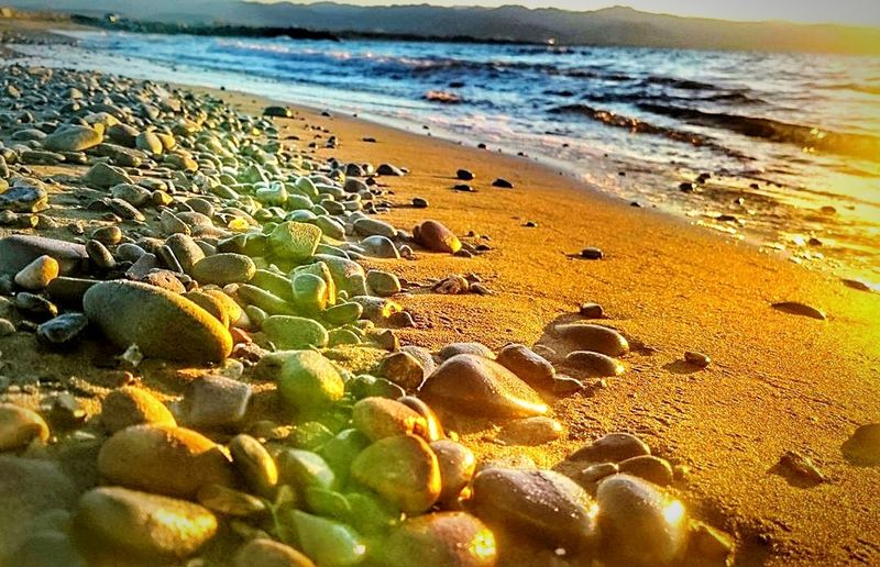 Beach Sea Water Nature Shore Wave Sand Outdoors Horizon Over Water Beauty In Nature Pebble No People Pebble Beach Day Sky My Photography Sunset Blue Nature People Blackandwhite First Eyeem Photo EyeEm Best Shots EyeEm Gallery EyeEmBestEdits