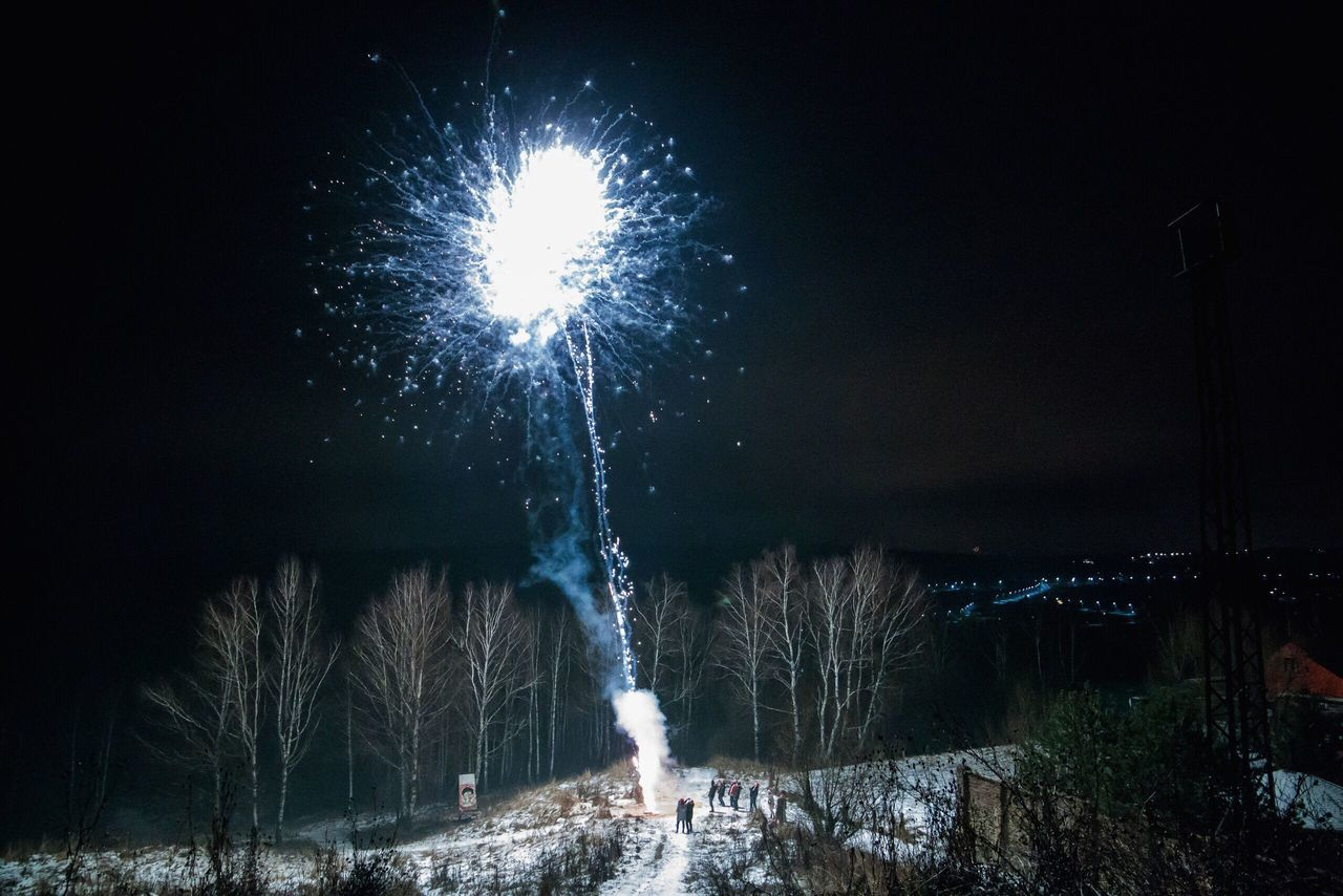 Firework display at night during winter