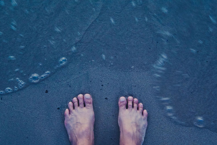 Foot at beach Adult Adults Only Barefoot Beach Close-up Day Directly Above High Angle View Human Body Part Human Foot Human Leg Lifestyles Low Section One Person Outdoors People Real People Sand Standing