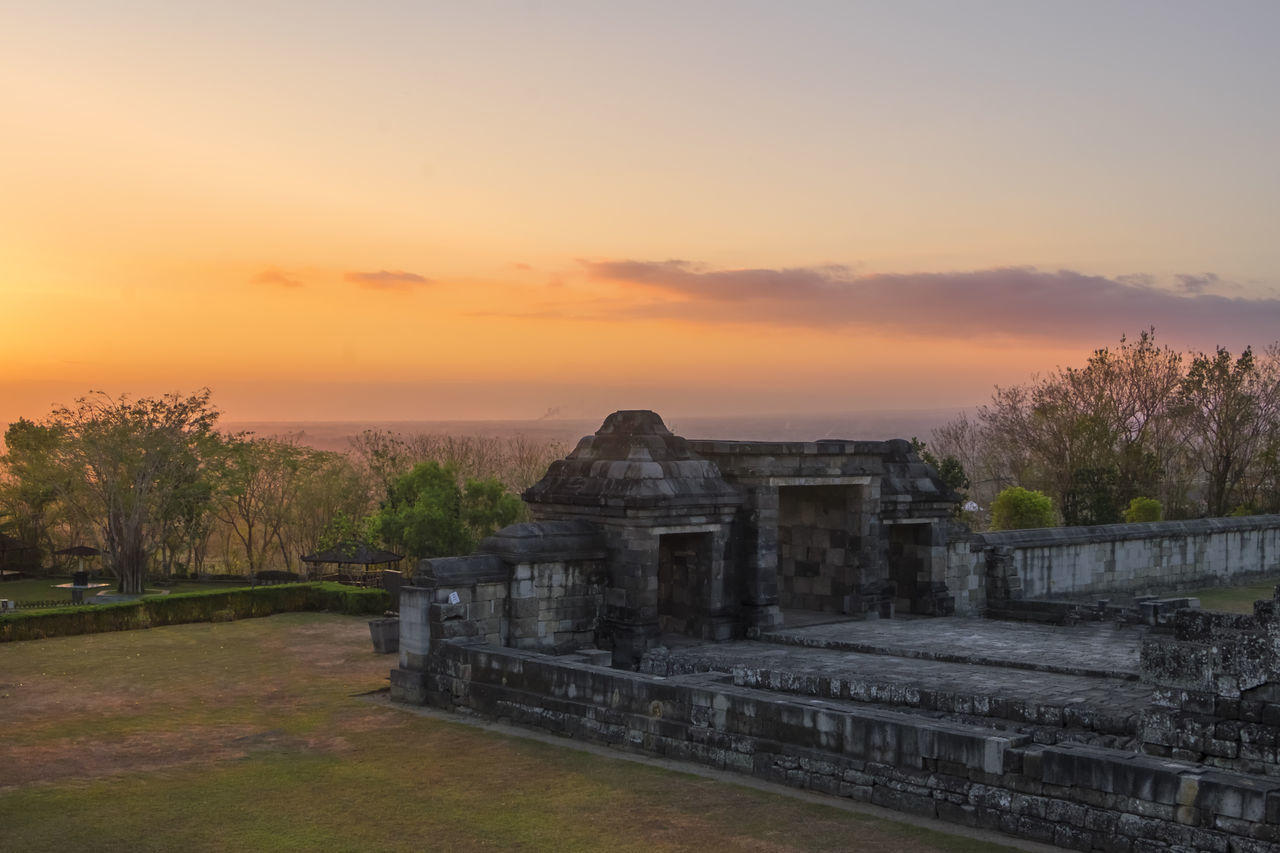 sunset, sky, architecture, built structure, nature, tree, orange color, history, no people, the past, building exterior, plant, cloud - sky, ancient, travel destinations, travel, environment, old ruin, outdoors, scenics - nature, ancient civilization, ruined, ancient history, archaeology